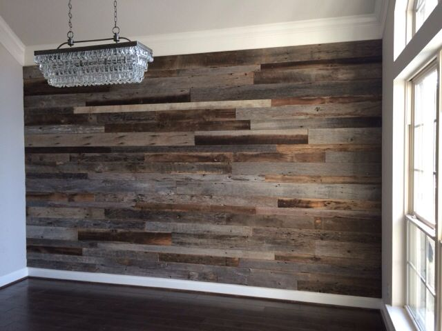Close up of the dining room reclaimed wood accent wall before the .